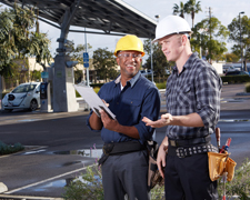 Two men conducting business energy survey