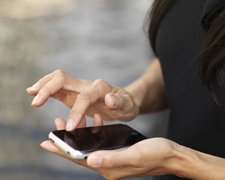 Woman checking alerts on mobile phone