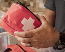Person holding safety kit