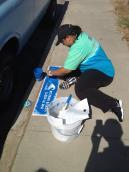 A volunteer at Chollas Creek cleanup
