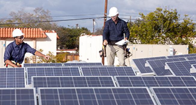 Engineers Checking Solar Panels