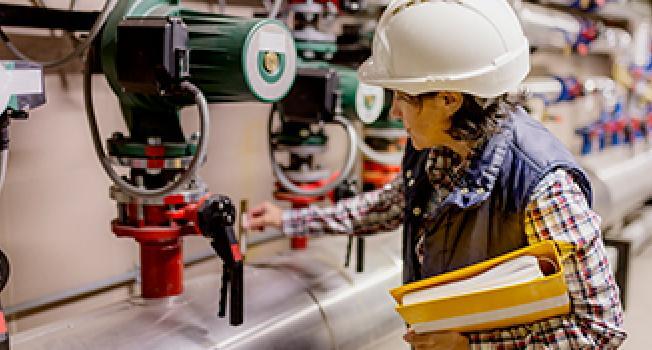 Female Engineer Checking Power-meter