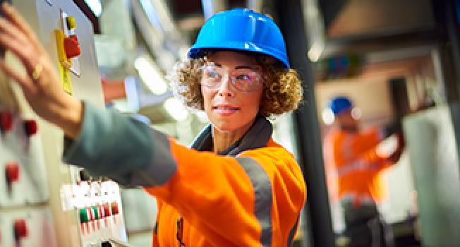 Female Engineer Operating Machine