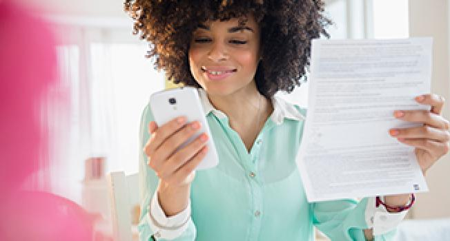 Girl Holding a Paper and a Phone