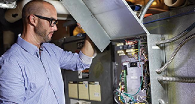 Guy Checking a Power Box